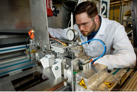 Dr. Scott Hammond, SolarWindow Technologies' Principal Scientist, prepares equipment for processing. (Photo: Business Wire)
