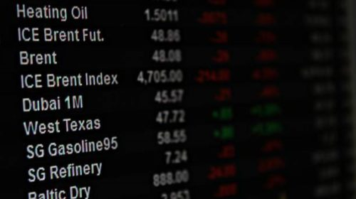 TSX up, Wall Street sets records, as loonie falls amid tumbling oil prices